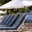 Stock Photo: Umbrelland Beach Chairs.