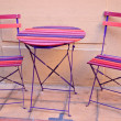 Stock Photo: Bright colored Table and Chairs
