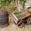 Antique Wheelbarrow and Barrel — Stock Photo