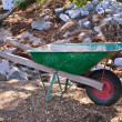Wheel Barrow and Stones — Stock Photo