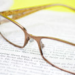 Eye Glasses on Book — Stock Photo