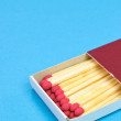 Boxed Matches on Blue — Stock Photo