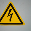 Stock Photo: Yellow Voltage Warning Sign