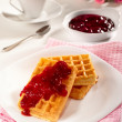Belgian waffles, jam and tea - Stock Photo