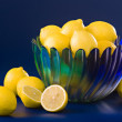Lemons in blue green bowl — Stock Photo #2854825