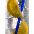 Drink with ice cubes, lemon and straw — Stock Photo