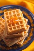 Apricot jam on Belgian waffle — Stock Photo