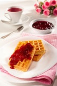 Belgian waffles, jam and tea — Stock Photo
