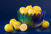 Lemons in blue green bowl — Stock Photo