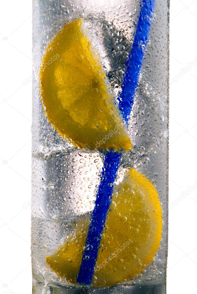 Glass of drink with ice cubes, straw and lemon slice  Stock Photo #2855114