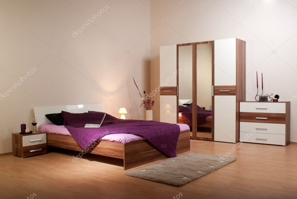 Bedroom interior showcase including bed, wardrobe, bedside table commodes, linen-press  — Стоковая фотография #3501711