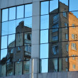 Reflection classic Moscow home in glass of modern daily building — Stock Photo