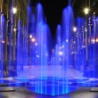 Stock Photo: Fountain illuminated at night near Moscow modern office block ..
