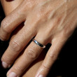 Wedding ring on womans finger — Stock Photo