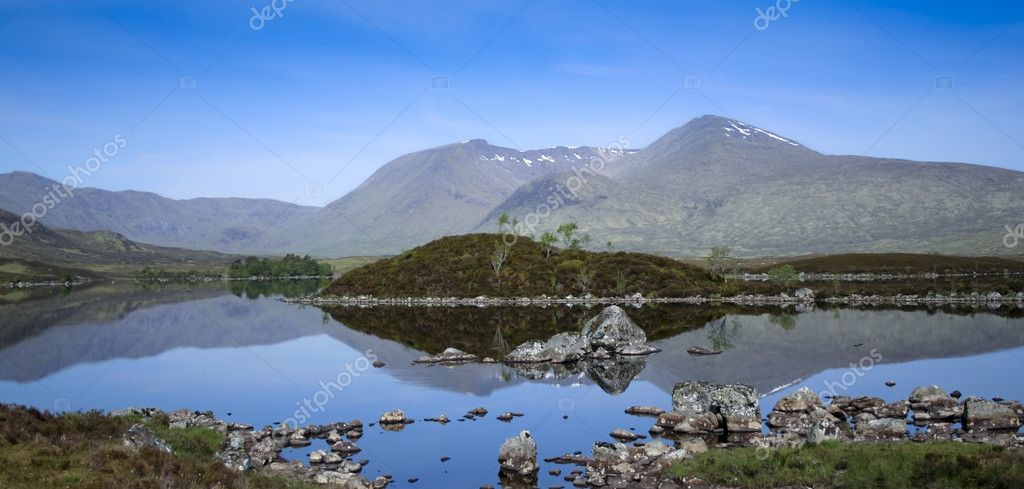 Mountains reflecting in the still waters of lakes on rannoch moor in the scottish highlands  Stock Photo #3507922