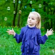 Girl and soap bubbles — Stock Photo