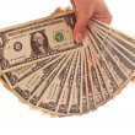 Money in woman's hand — Stock Photo