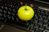 Keyboard and apple — Stock Photo