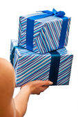 Blue gifts boxes in hands — Stock Photo