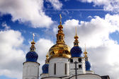 Cathedral domes against sky and clouds — Stock Photo