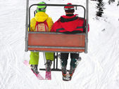 Two skiers on chairlift — Stock Photo