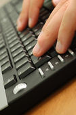 Male hands on computer keyboard — Stock Photo