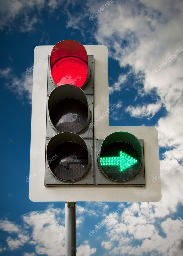 City traffic light on blue sky background. — Stock Photo #3318171