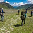 Hikers in mountain wally. — Stock Photo