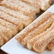 Pastry cakes with sugar on plate. — Foto de Stock