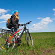 Cool girl riding a bicycle. — Stock Photo