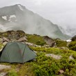 Gray camping tent in mountains. — Stock Photo