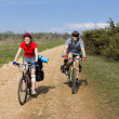 Couple of cyclists have a bicycle travel. - Stock Photo