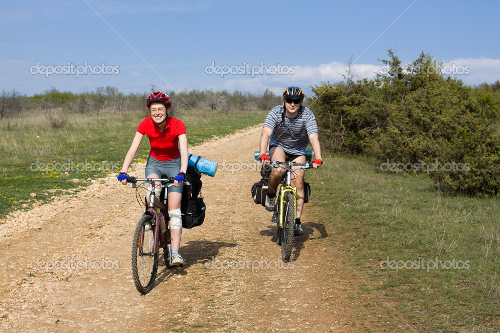 Bicycle travel. Couple of cyclists go to road. Bike Touring. — Stock Photo #3879819