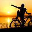 Girl with bicycle. - Stock Photo