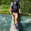 Backpacker crossing the river. — Stock Photo #3893538