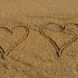 图库照片: Two hearts on the beach.