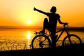 Girl with bicycle. — Stock Photo