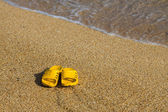 Sandals on beach — Stock Photo