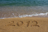 Year 2012 written on the sand — Stock Photo