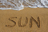 Word sun on the beach. — 图库照片