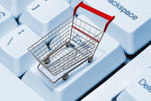 Shopping cart on computer keyboard — Stock Photo