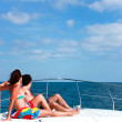 Couple Sunbathing On The Bow Of The Boat — Stock Photo #2841352