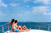Couple Sunbathing On The Bow Of The Boat — Stock Photo