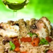 Italian Cuisine - Risotto With Octopus - Stock Photo