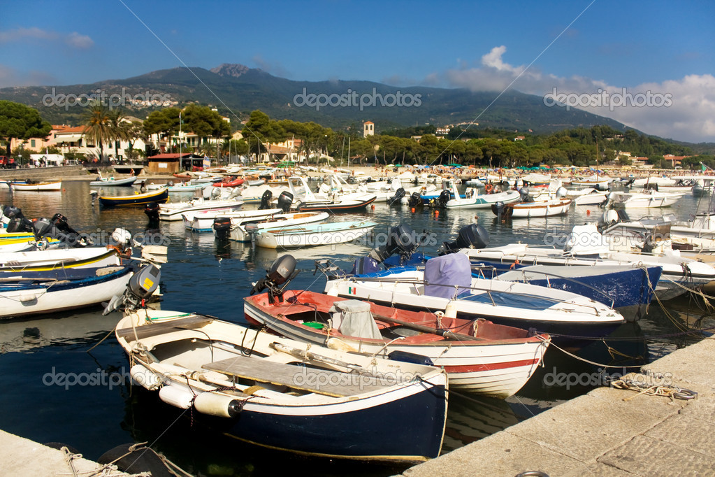 Travel - Italy. Colorful boats crowded in the small harbor of Marina Di Campo, Elba Island, Italy. — Stock Photo #3860253