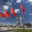 Tiananmen Square with red flag flying in - Stock Photo
