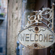 Welcome sign on log home — Stock Photo #3109766