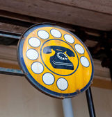 Antique phone sign — Stock Photo