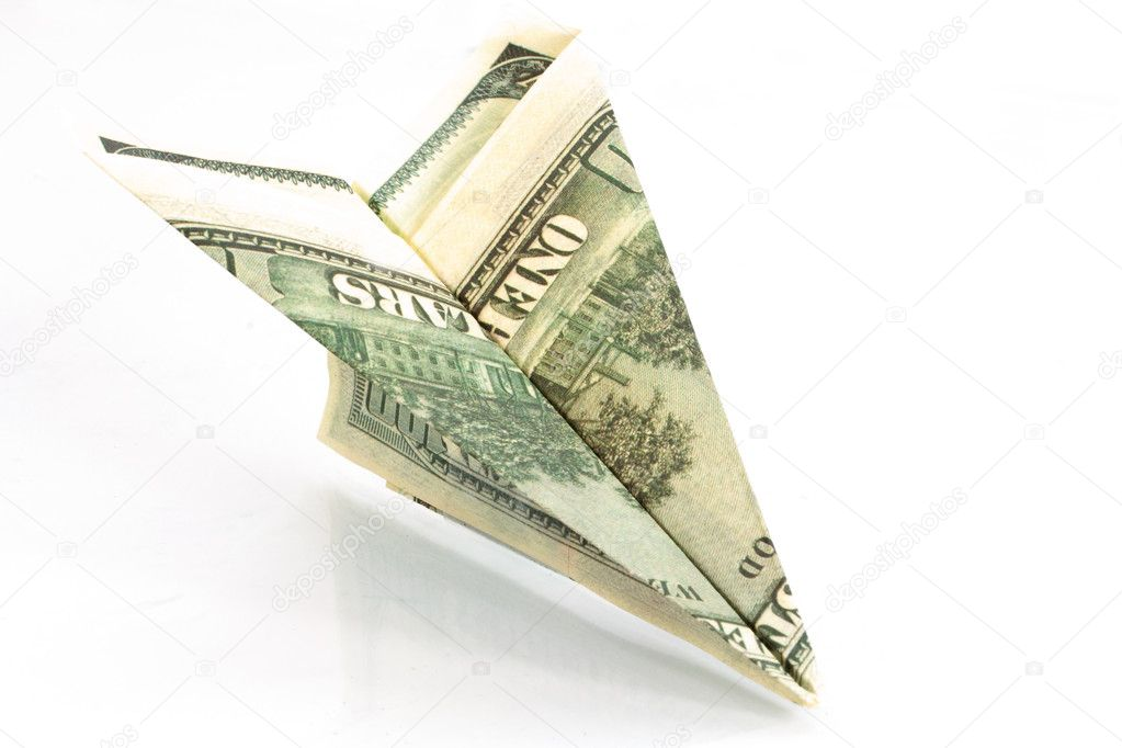 Plane from dollars isolated on a white background  Stock Photo #3558463