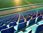 Empty plastic seats in a stadium — Stock Photo